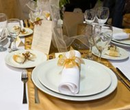 gold place setting for an anniversary party