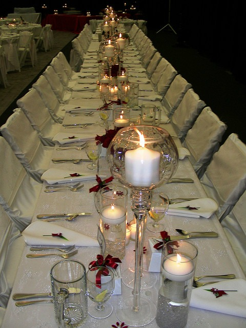 red ribbons decorating anniversary party tables