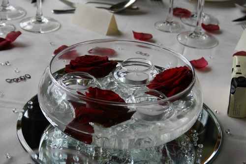 red rose and floating candle centerpiece